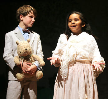 Pictured is Christopher Robin, played by Jackson Hayes, and the narrator, played by India Young.