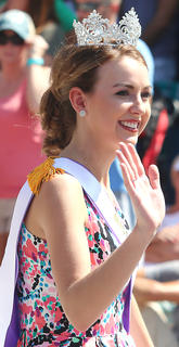 Miss Kentucky County Fair Bethany Roberts waves to the crowd during the Pigasus Parade.