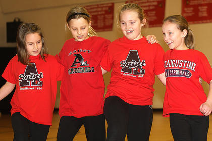 From left, Bethany Masterson, Nicole Mattingly, Emily Clark and Leah Wright perform a dance routine.