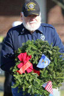 Fred McClure presents a special wreath for the United States Air Force.