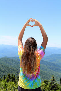Pictured is Macy Bradshaw showing her Alpha Omicron Pi love at Clingman's Dome in the Great Smoky Mountains.