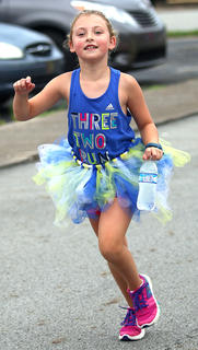 Olivia Spalding shows off her pretty smile as she nears the finish line.