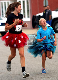 Vanessa VanWhy, right, is giving it all she's got as she nears the finish line.