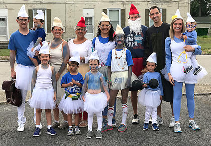 The Smurf family won awards for having the largest family and the best theme at the Back Tutu School event. Pictured, front row from left, are Emerson Osbourne, Salem Bowman, Eliot Osbourne, Amira Bowman and Dylan Leathers; back row from left, are Jesse Osburne holding Whitman Osbourne, Coury Osbourne, Dee Leathers, Mikki Jo Bowman, Freddie Leathers, Michael Leathers and Amanda Leathers holding Ethan Leathers.