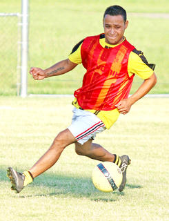 Luis Cruz Martinez looks to get control of the soccer ball in the alumni soccer match on Friday.