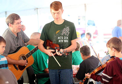 Pictured, from left, are Abraham Kelly, Dan Kelly, Isaiah Kelly and Sam Kelly playing music for people at the country ham breakfast Saturday morning at Ham Days.