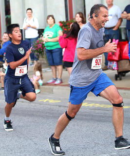 Barry Shewmaker of Lebanon digs deep as he finishes the Pokey Pig 5K Saturday. Shewmaker will be running the Chicago Marathon on Sunday, Oct. 8. We wish him the best of luck. Also pictured is Noe Serrano of Lebanon.