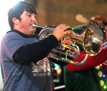 Marion County High School freshman Clint Vandyke plays the baritone with the Marion County High School Band in the Dickens Christmas Parade Friday evening.