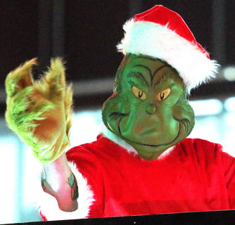 The Grinch made an appearance in the Dickens Christmas Parade Friday evening.