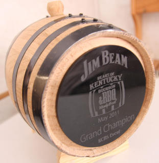 The trophies for the Bourbon and BBQ Musicfest were shaped like small bourbon barrels. Nuke 'Em Graphics engraved the plates for each category and the grand champion.