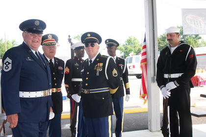 Members of the Marion County Honor Guard wait for the start of Saturday's festivities. From left, they are Paul Paul, Frank Bland, David Thompson, Lynn Farmer, James Porter and Tommy Bland.