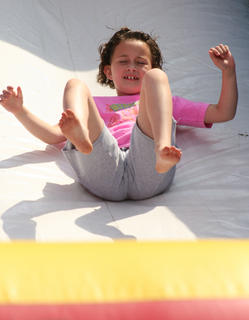 Brianna Thomas, 8, takes a turn on the slide.