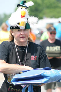 Connie Wibbels turns in the chicken entry for the team Monty Pigthon and the Holy Grill.