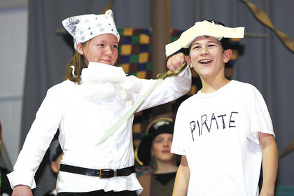 Aaron Howard, right, who played the lead in the musical, expresses his desire to become a real pirate. Also pictured is Kali Schneider.