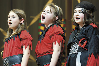 Pictured, from left, are Christy Bland, Rachel Fitzpatrick, and Samanta Fisher singing during the musical.