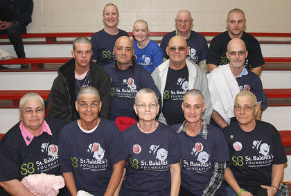 And here they are after their haircuts. Front row (from left): Mary Mattingly, Karen Goff, Sue Beavers, Shelia Moore, and Geraldine Mattingly. Back row: Amanda Bickett, Sammy Mattingly, O'Dell Mattingly, and Robert Mattingly. Back row: Teresa Albright, Gracie Cooper, Tommy Beavers, and Adam Moore.