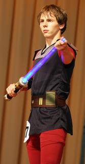 Dalton Mills holds his light saber while performing an original Star Wars routine during the talent competition. Mills was named the 2011 Junior Mister, and received audience choice award.