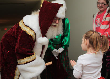 Emerson Barnes, 3, of Lebanon has a word with Santa at Lebanon Health and Fitness.