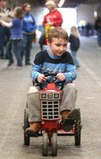 Nicholas Spalding competes in a pedal pull sponsored by the Marion County Future Farmers of America during the Heart of Kentucky Farm, Home and Garden Show at the Tobacco Receiving Station. The Marion County Chamber of Commerce event attracted hundreds of visitors April 2-3.