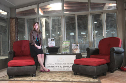 Mallory Hill of Sunrooms and More takes a short break in between visitors.