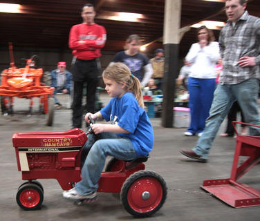Naveah Hutchins pulls her weight and then some during a pedal pull competition sponsored by the Marion County chapter of the Future Farmers of America.