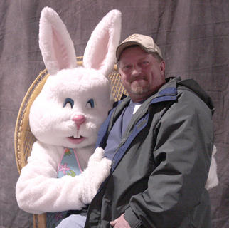 The Easter Bunny poses with Tom Tharp at the 12 Kids for a Cure booth, which raises money for Relay for Life.