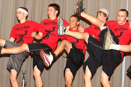 The Junior Mister participants do the Can-Can during the fitness portion of the competition. They are, from left, Craig O'Daniel, Bryan Gootee, Kendall Taul, Scott Hunt and Cody Brahm.