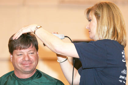 Steve Baudendistel waits to be shaved by Eileen Hughes.