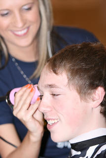 Jared Wheatley prepares to get shaved by Stephanie Lee.