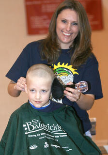 Logan's brother, Benjamin, gets a haircut from Sherry Moore.