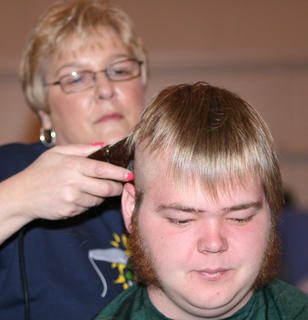 Three-time shavee Jay Bland grew sidebars prior to the event. (They stayed on even after his head was shaved.)