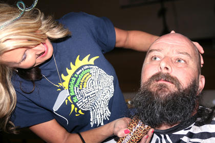 Charles Thompson said he was willing to shave every hair on his body to help fight children's cancer. Jessica Baker just clean up the top of his head and his face, however.