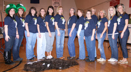 Several local stylists donated their time and talent to the St. Baldrick's cause. They pose with the fruits of their labors. From left: Taylor Claypool, Kim Childers, Candi Skaggs, Sherry Moore, Mindy Garrett, Eileen Hughes, Vickie Childers, Polly Miller, Darlene Morgan, Connie Smith, Jessica Baker, Laken Kirkland and Stephanie Lee.