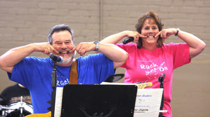 Gene Laferty and his wife, Tamie, both members of the band Spirit Seekers, encourage the crowd to smile during their performance Saturday at Centre Square. The performance was part of the Heart of Kentucky Christian Youth Rally Sept. 9 at Lebanon Middle School and Sept. 10 at Centre Square.