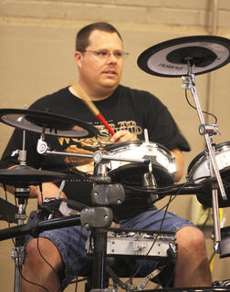 Event organizer Dan Lawson fills in on the drums during Spirit Seekers' performance Saturday.