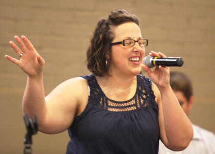 Brooke Gupton belts out a note while singing with Rock of Ages Saturday afternoon.