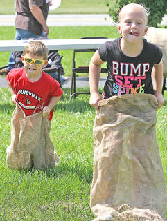 Owen Daugherty, left, and Ava Spalding compete in the sack races.