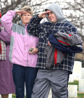 Judy Tharp and her grandson, Trent Higdon, salute the flag during the National Anthem.