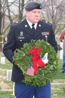 Staff Sgt. Douglas Hoisington lays a remembrance wreath in memory of those who served and are serving in the United States Army.