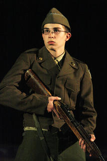 Pictured is Vincent Pigati. The program included a brief history about all of the country's armed conflicts.