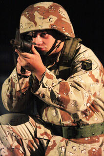 Pictured is Andrew Villanueva. The program included a brief history about all of the country's armed conflicts.