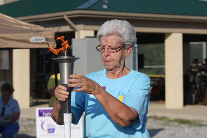 Martha Elder places the torch at the beginning of the 2010 Relay for Life.