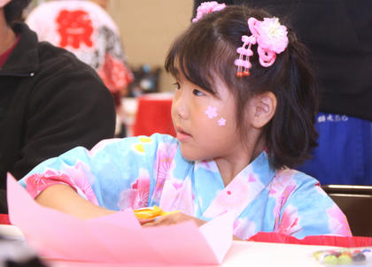Yuna Gorie, 6, works on an origami project. She made a rabbit.