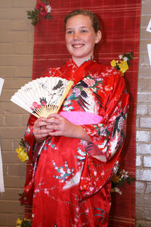 Mary Ann May poses for a picture in a kimono.