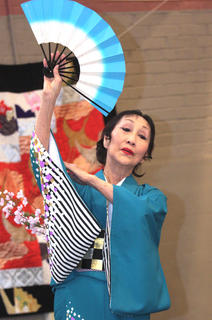 Marjorie Yamafuji performs a traditional folk dance with the Indianapolis Minyo Dancers.
