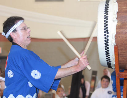 Roger Gage, co-director of the Cincinnati-Dayton Taiko Drummers, performs a solo.