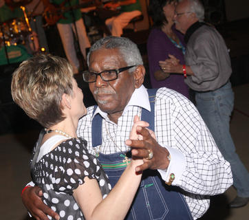 Obie Slater dances with Janice Crews during the Jimmy Church Band's performance Friday night at Centre Square.