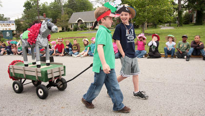 Davis Nelson (green shirt) and Will Fowler escorted the float made by Karyn Spalding's class.