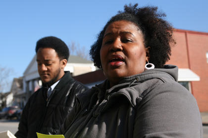 Maria Bell, president of the United Concerned Citizens Organization, reminds of the reason they are marching. Eric Bell is in the background.