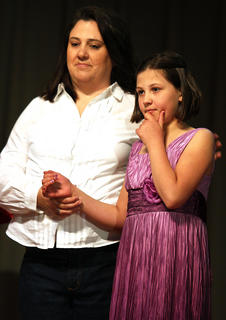 This year's Make-A-Wish recipient, Emily Langford, 10, of Lebanon, stands on stage with her mother, Tina. Emily was born with Pulmonary Atresia, a form of congenital heart disease in which the pulmonary valve does not form properly. She has had to undergo multiple heart surgeries to fight her illness. Thanks to the students at Marion County High School, Emily will get her one true wish, which was to go to the theme parks in Orlando, Fla.